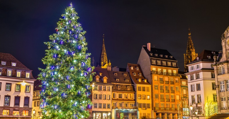 christmas tree and old buildings at austrian, swiss and german christmas markets tour