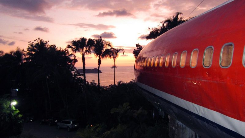 boeing 727 in rainforest at sunset