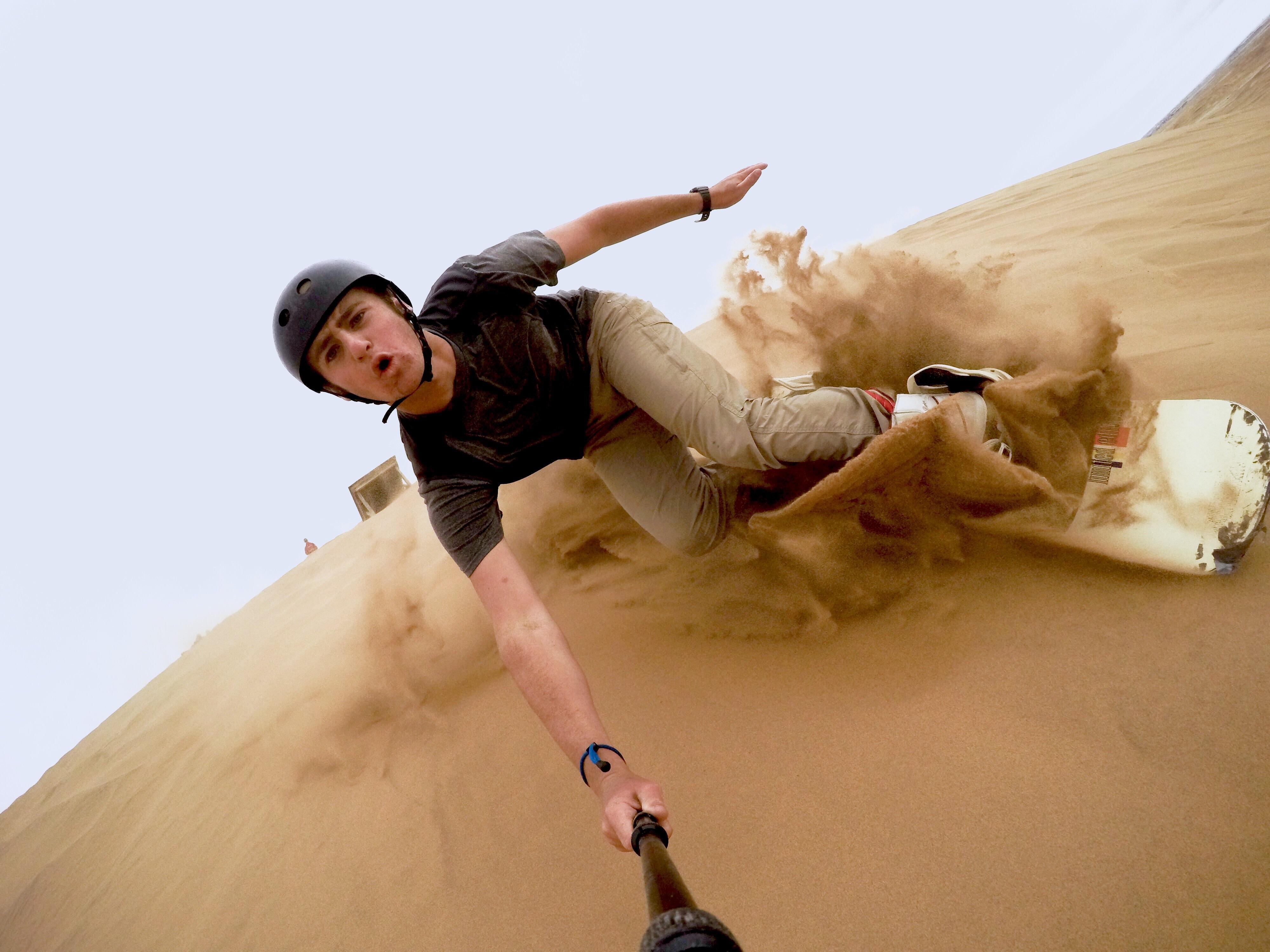 selfie stick go-pro sandboarding namib desert