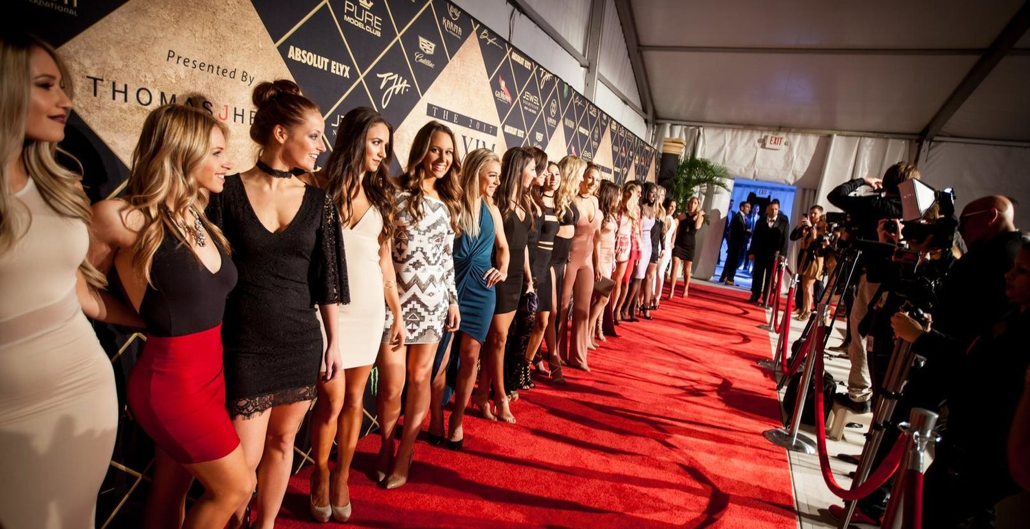 celebrities on the red carpet at maxim super bowl party