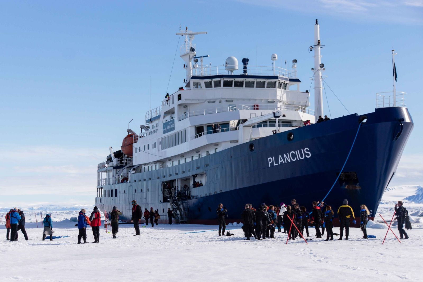 ship and ice floe with people on ice on arctic polar bear tour