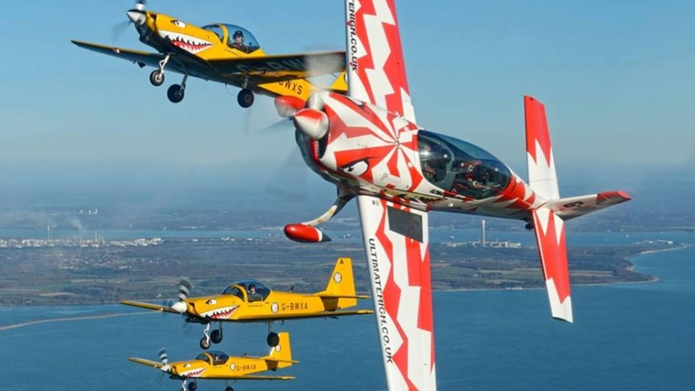 nutter butter flying experience red, white and yellow planes