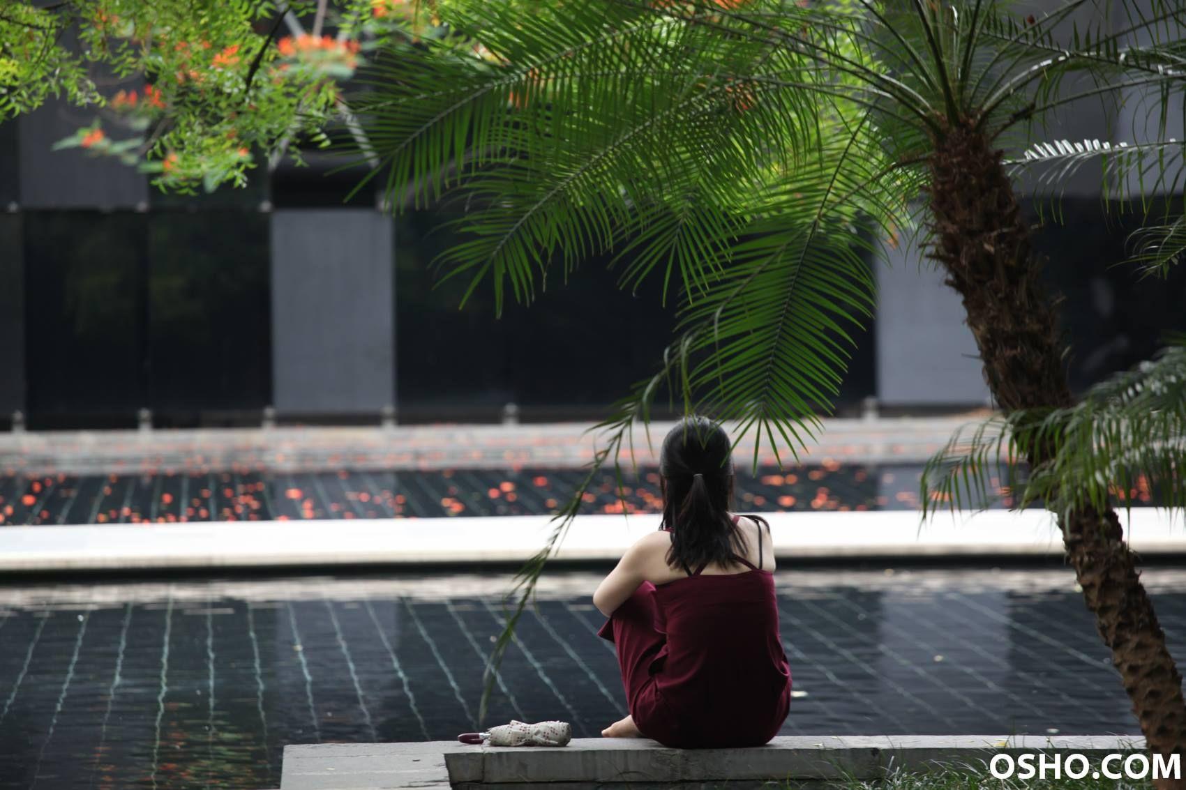 Woman meditating at Osho Zen Retreat