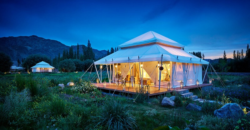 the ultimate travelling camp lit up at night