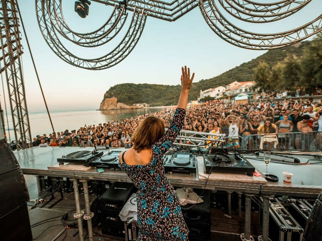 female dj entertaining the crowd at Sea Dance Festival