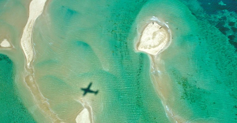 shadow of plane over ocean at vamizi private island