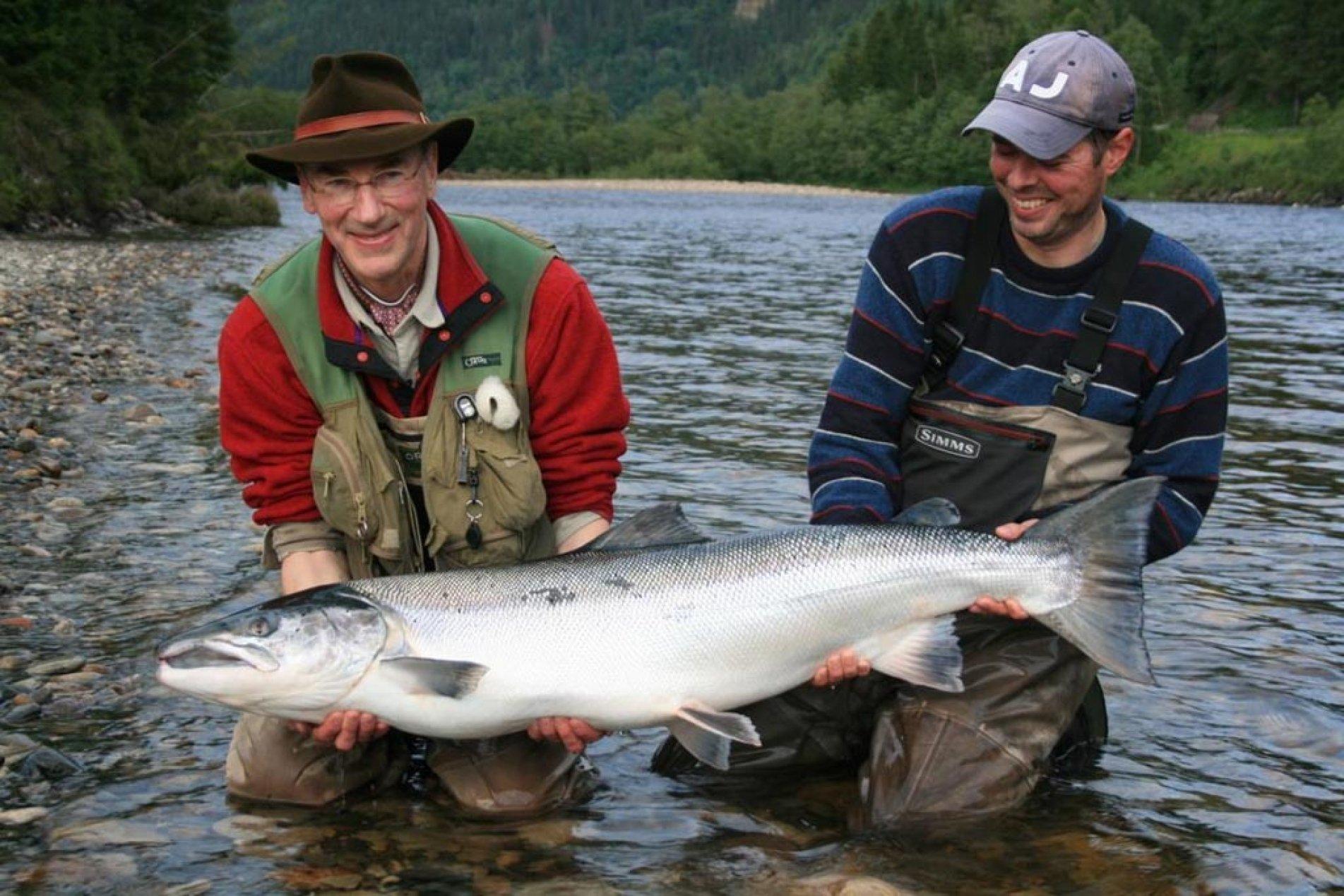 salmon fishermen in norway with huge salmon