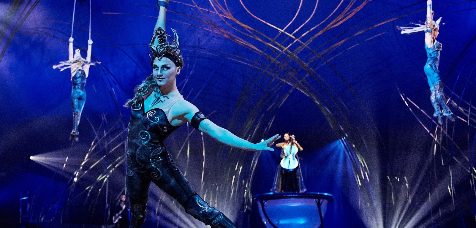 cirque du soleil acrobats and performers in costume in amaluna