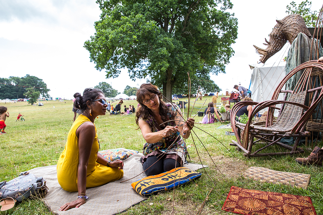 women doing wickerwork crafts at the green gathering