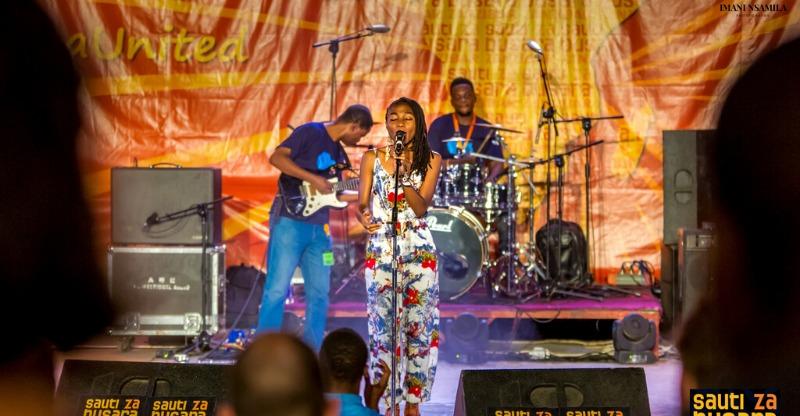 sauti za busara musician singing on stage