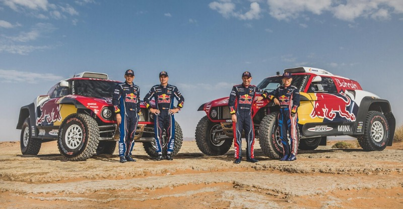 dakara rally red bull cars and drivers posing in desert