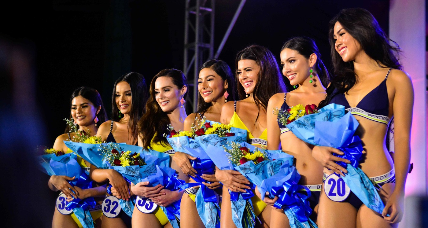 miss world contestants with flowers and bikinis