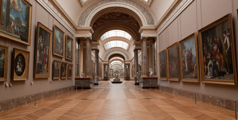 paintings on the wall at laught the louvre