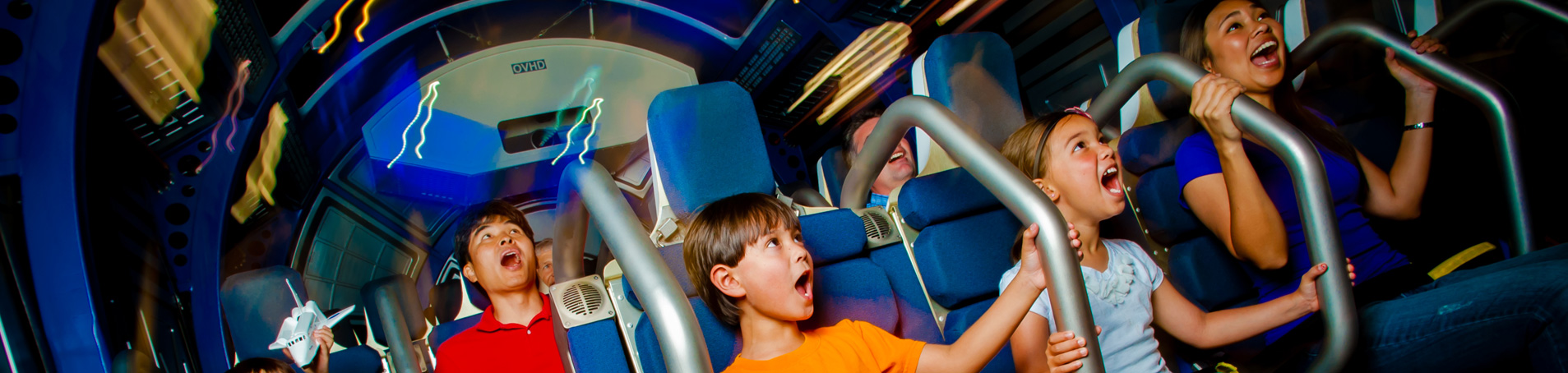 children enjoying fly with an astronaut at kennedy space centre
