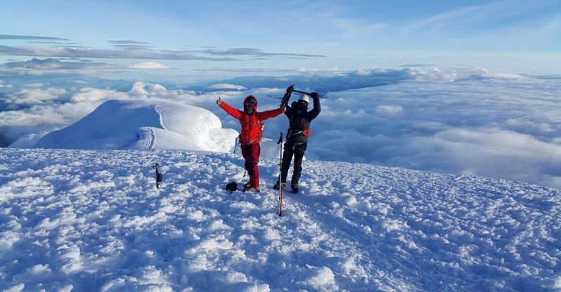 Cayambe volcano climbers in snow