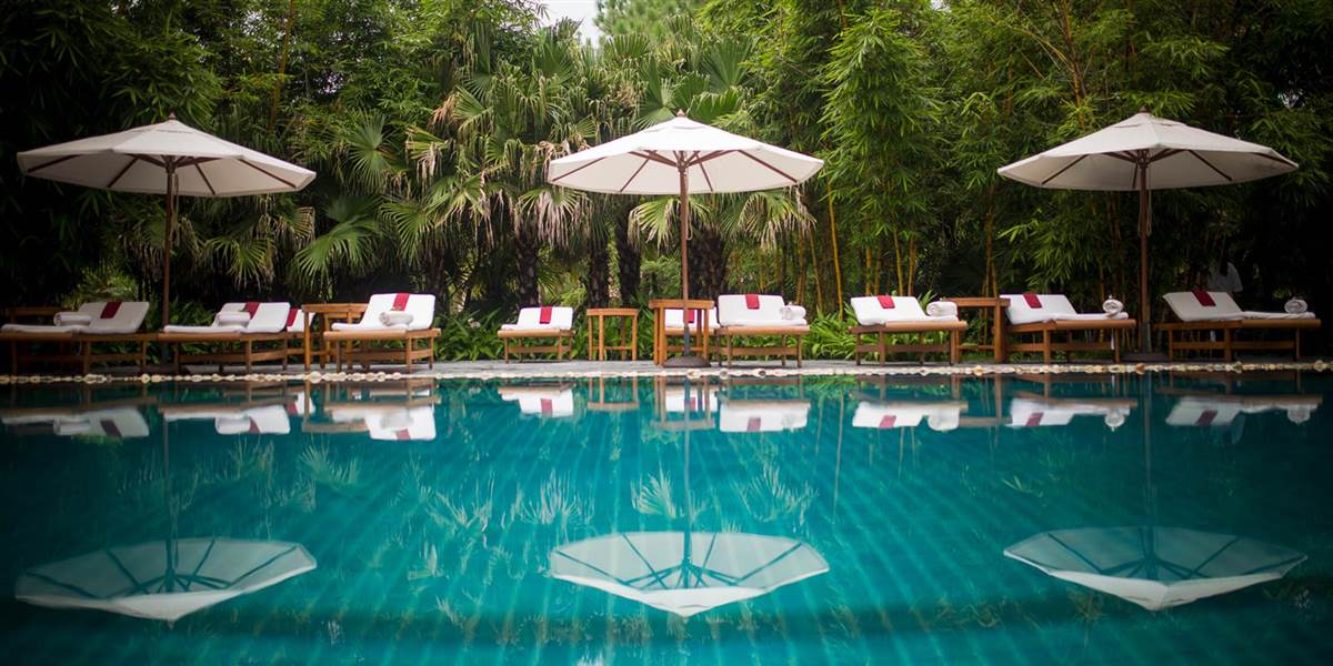 sun loungers and parasols at ananda couple retreat