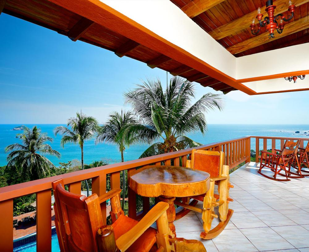 Costa Verde chairs on balcony overlooking ocean view