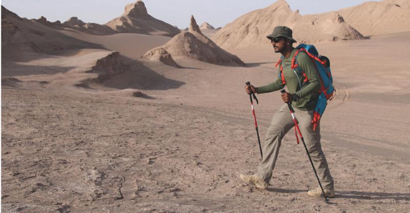 man trekking in desert on iran desert trek