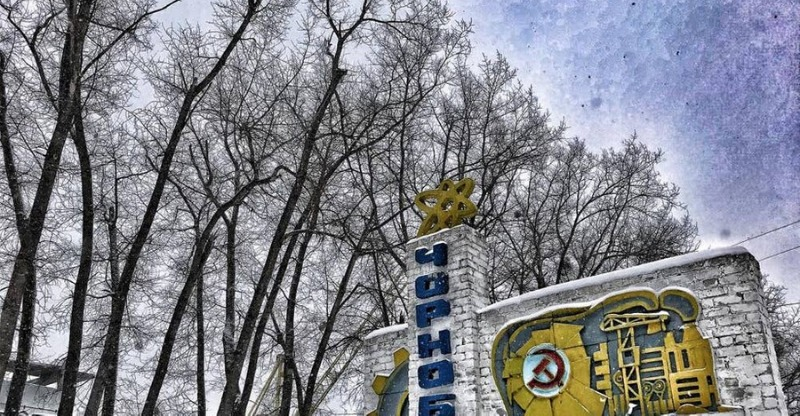 trees and abandoned sign in chernobyl