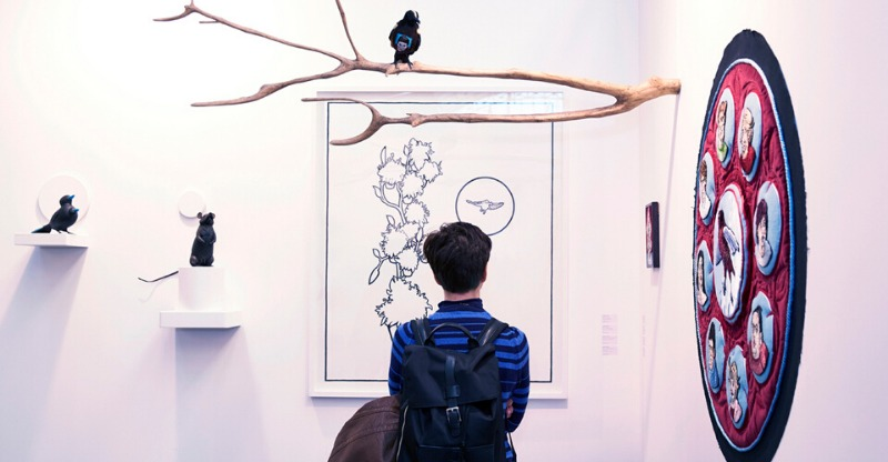 london art fair exhibit with birds and line drawing