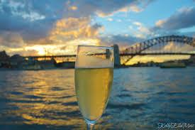 champagne celebration in front of sydney harbour bridge