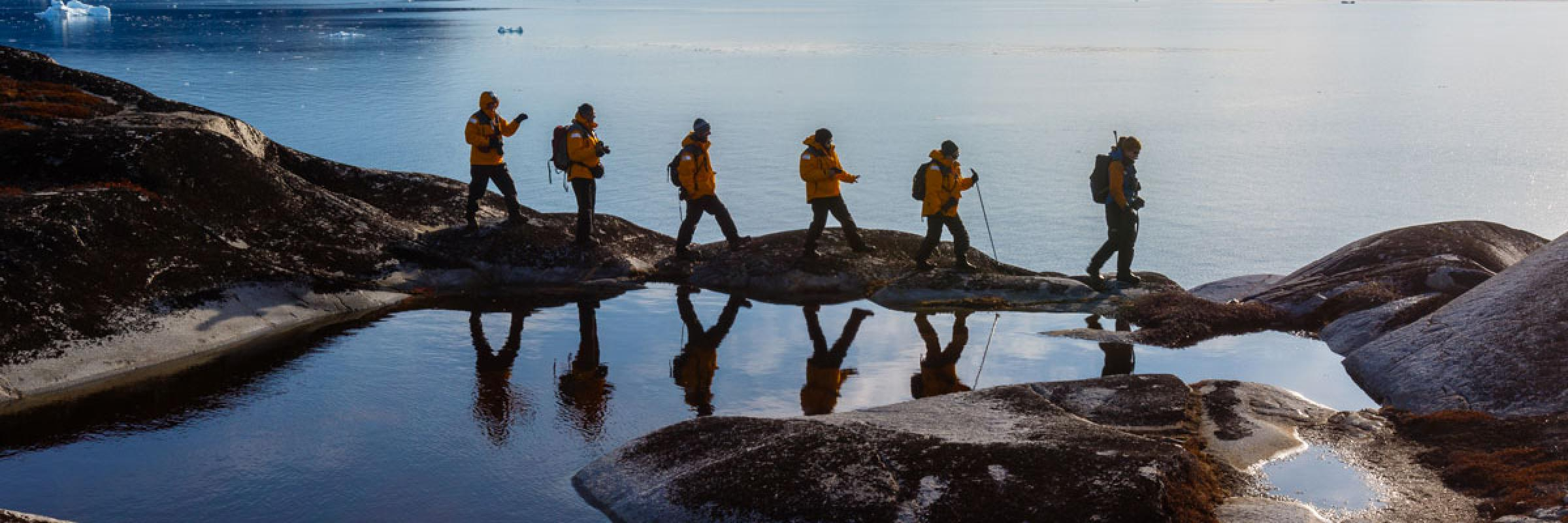 six hikers trekking in svalbard arctic archipelagos