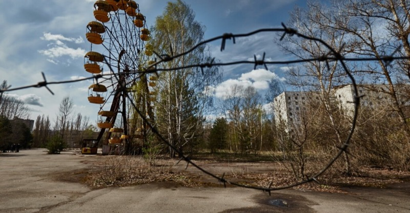 barbed wire and abandoned fairground ride in chernobyl