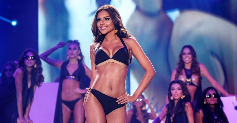 miss colombia in bikini posing on stage