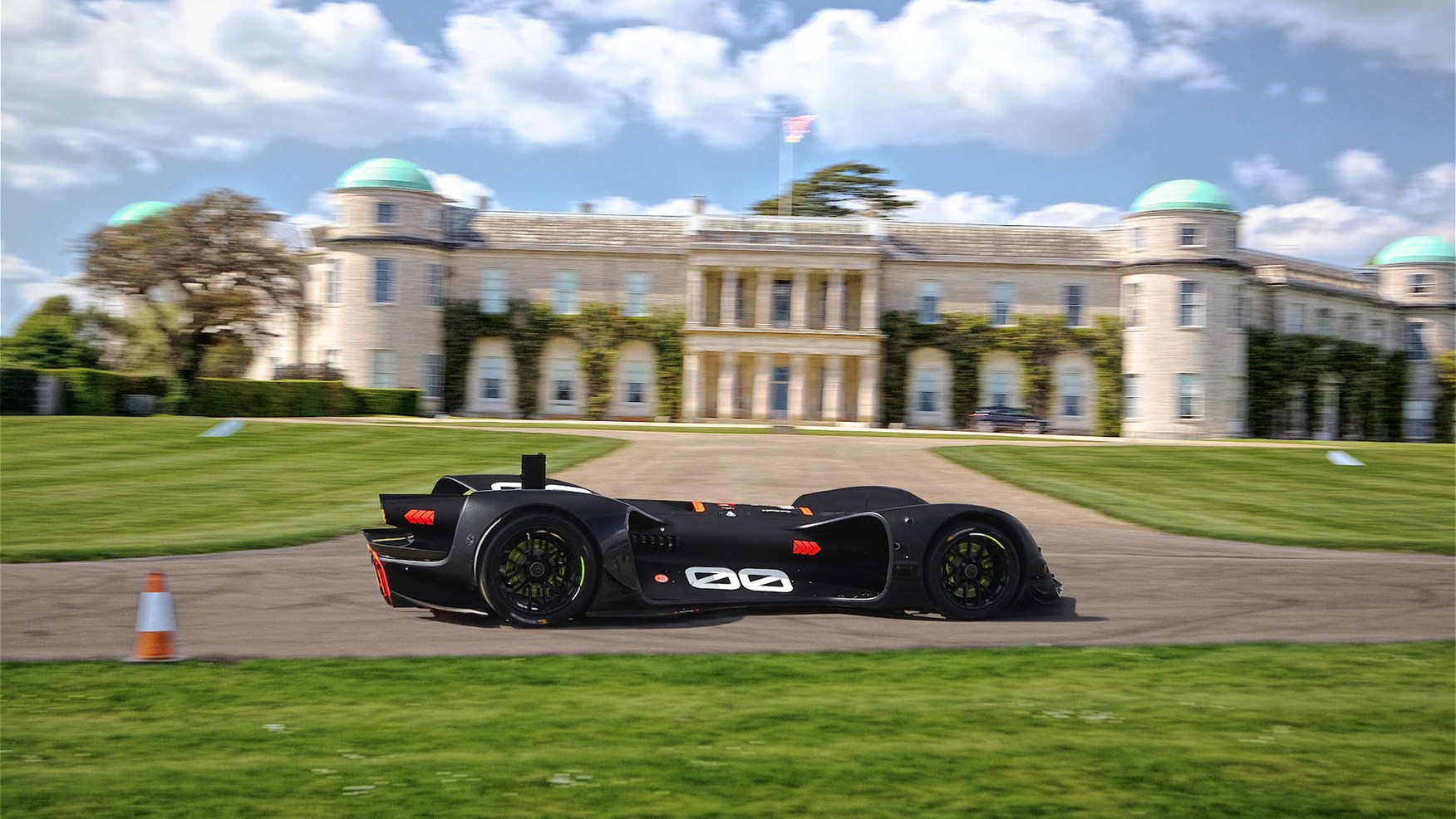 sports car in front of grand mansion house at Goodwood Festival of Speed