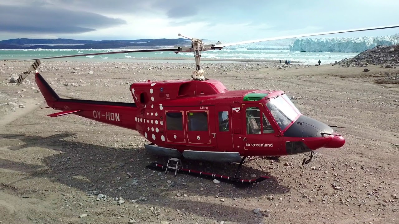 red helicopter on beach on iceland and greenland photography tour