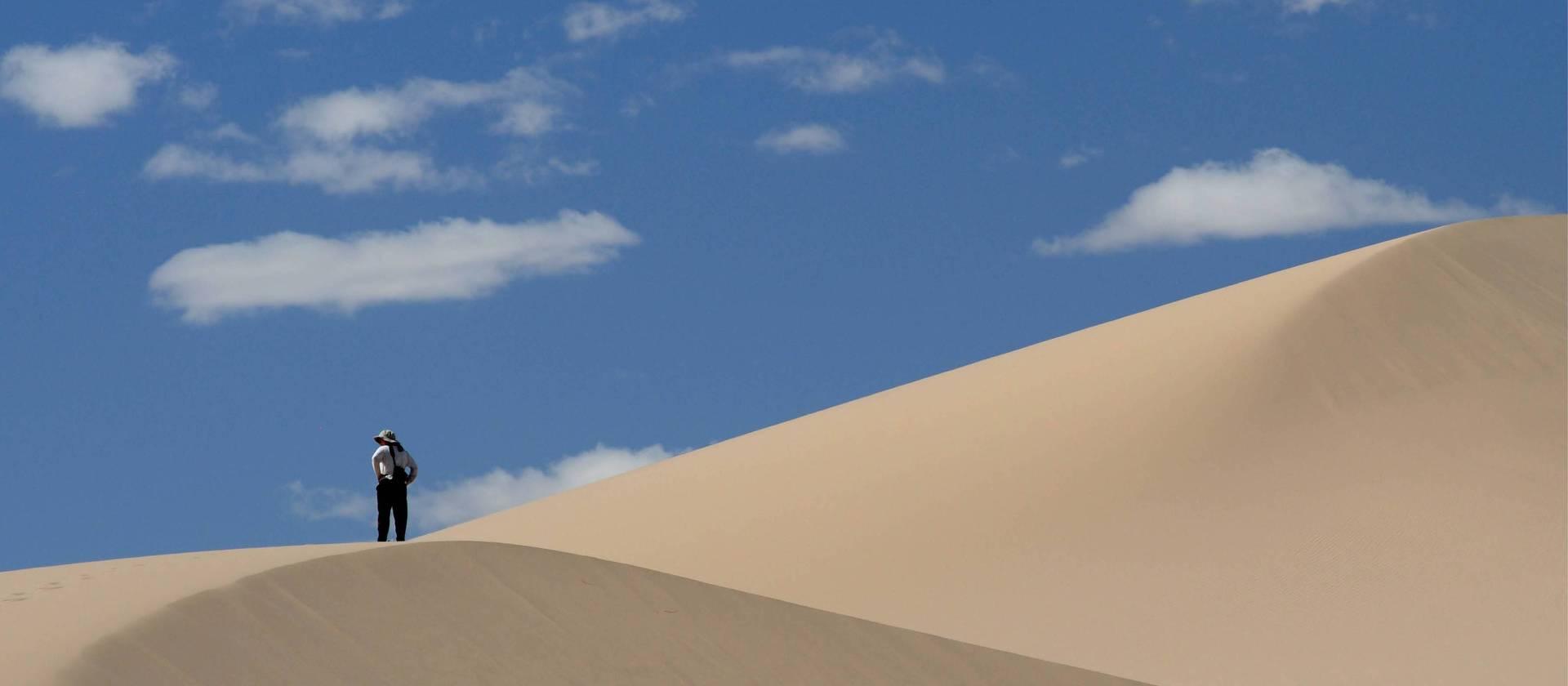 person hiking on gobi desert trek