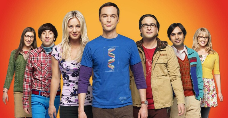 big bang theory cast with orange background