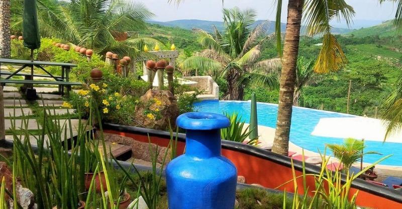 hillburi mountain escape pool and palm trees