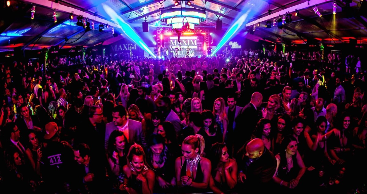 maxim superbowl party crowds and stage