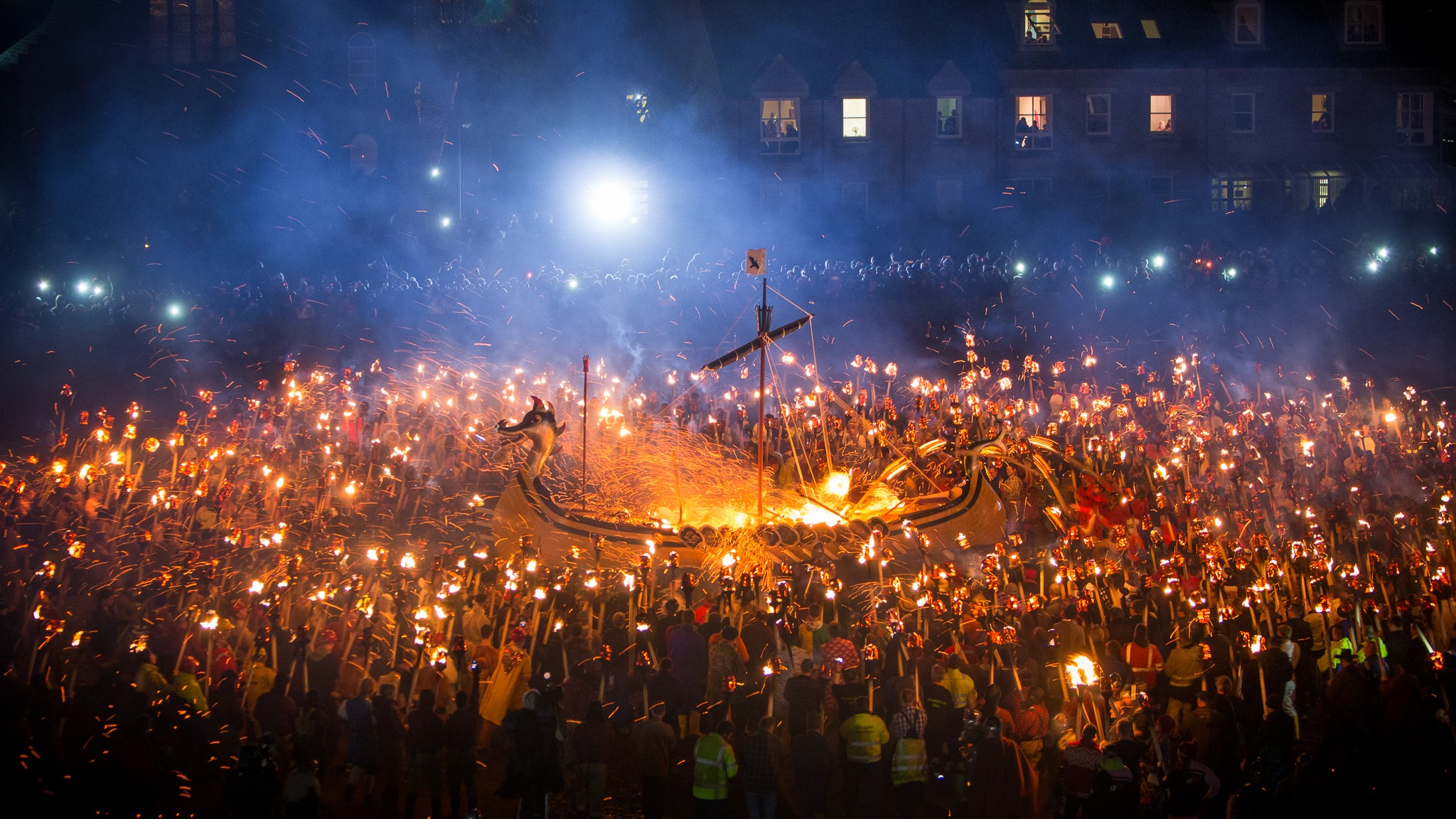 Up Helly Aa Viking longship and crowds celebrating