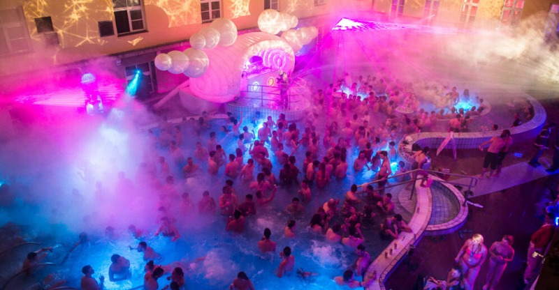 crowds partying in the pool at night at Sparty Budapest