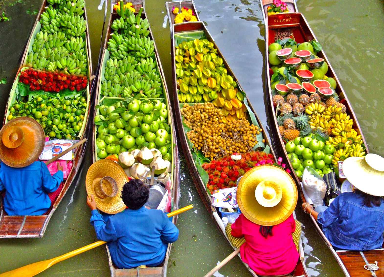 Taste of Thailand Food Tour with floating market boats with brightly coloured fruit and vegetables