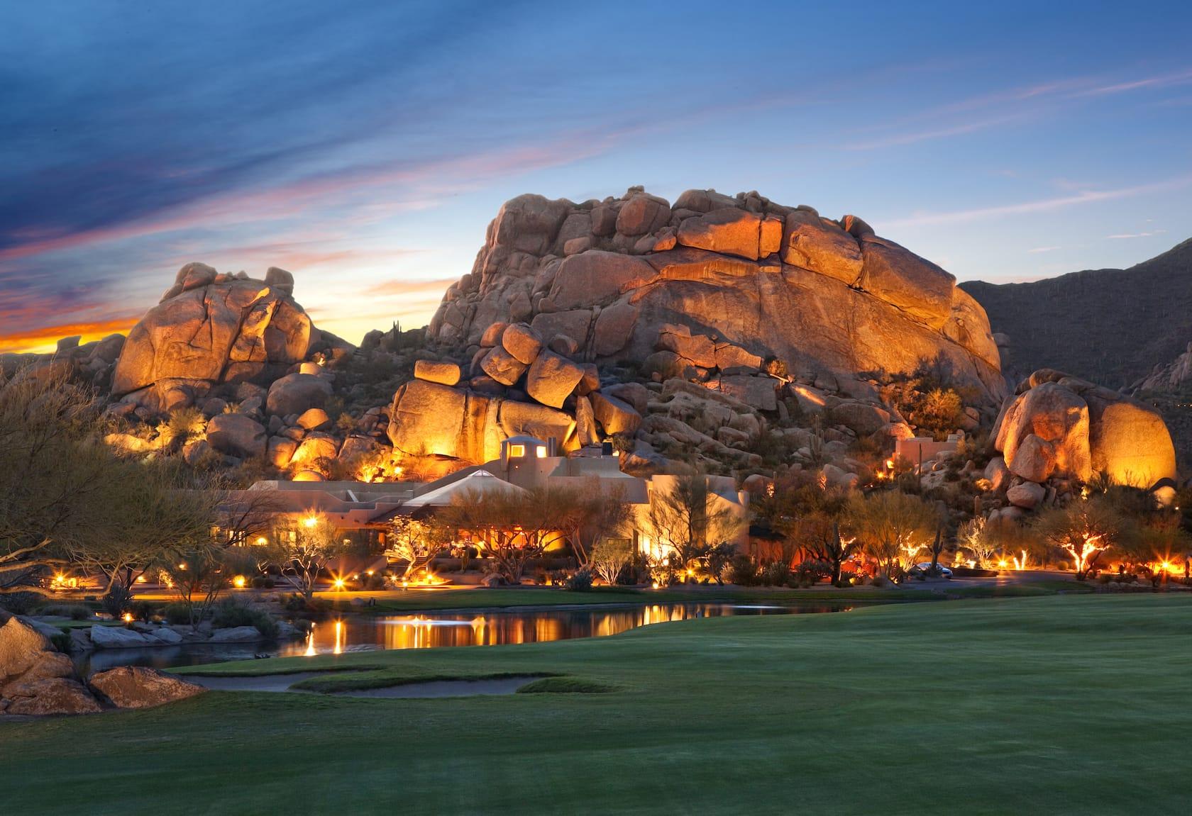 lit up rocks and pool at boulders resort