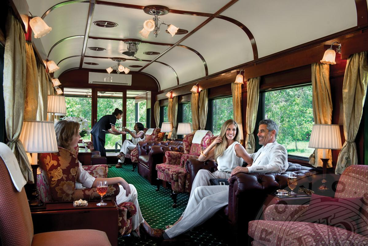 Couple inside luxury carriage of Pride of Africa train
