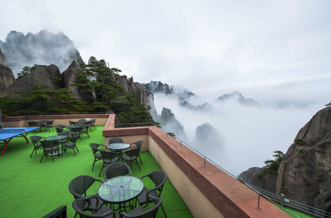 tables and chairs on balcony at Yuplinglou Hotel in the clouds