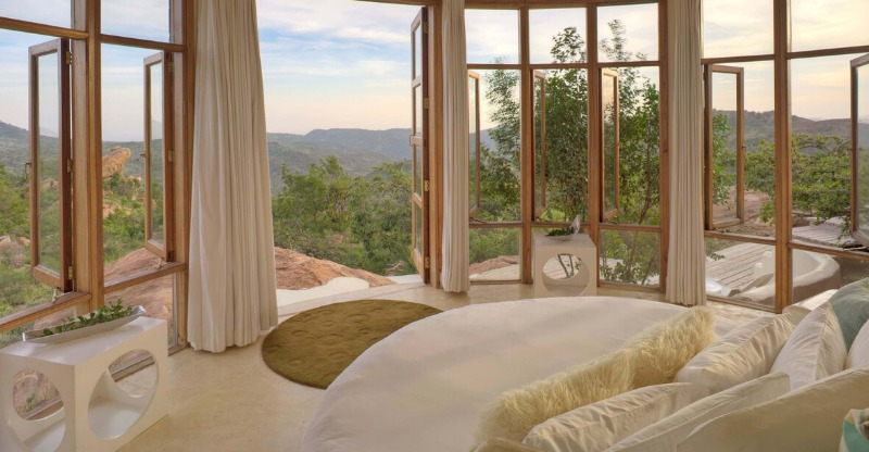 santuary of ol lentille room with windows overlooking african plains