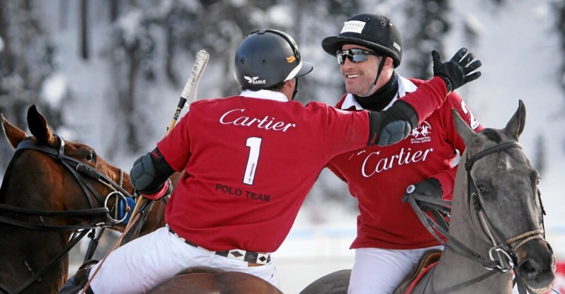 cartier snow pol riders greeting each other on horseback