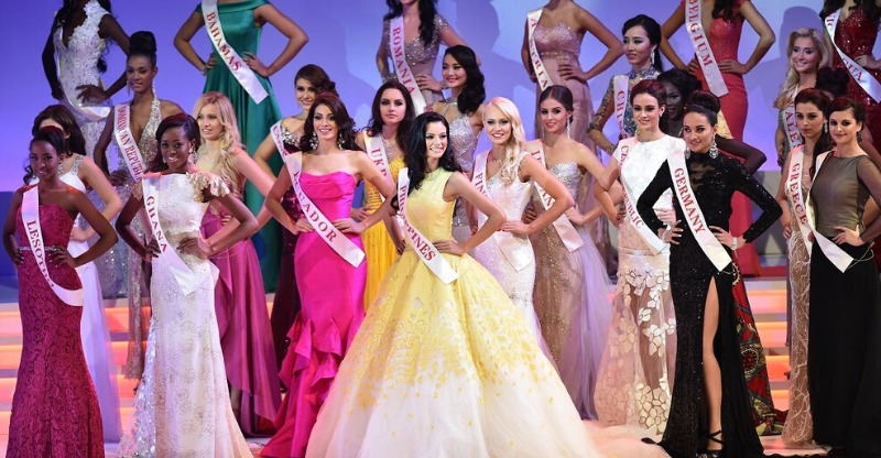 miss world contestants in ball gowns on stage