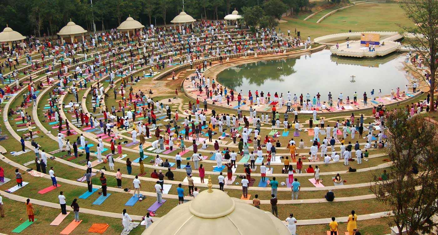 people meditating by lake at discourse, music and meditation