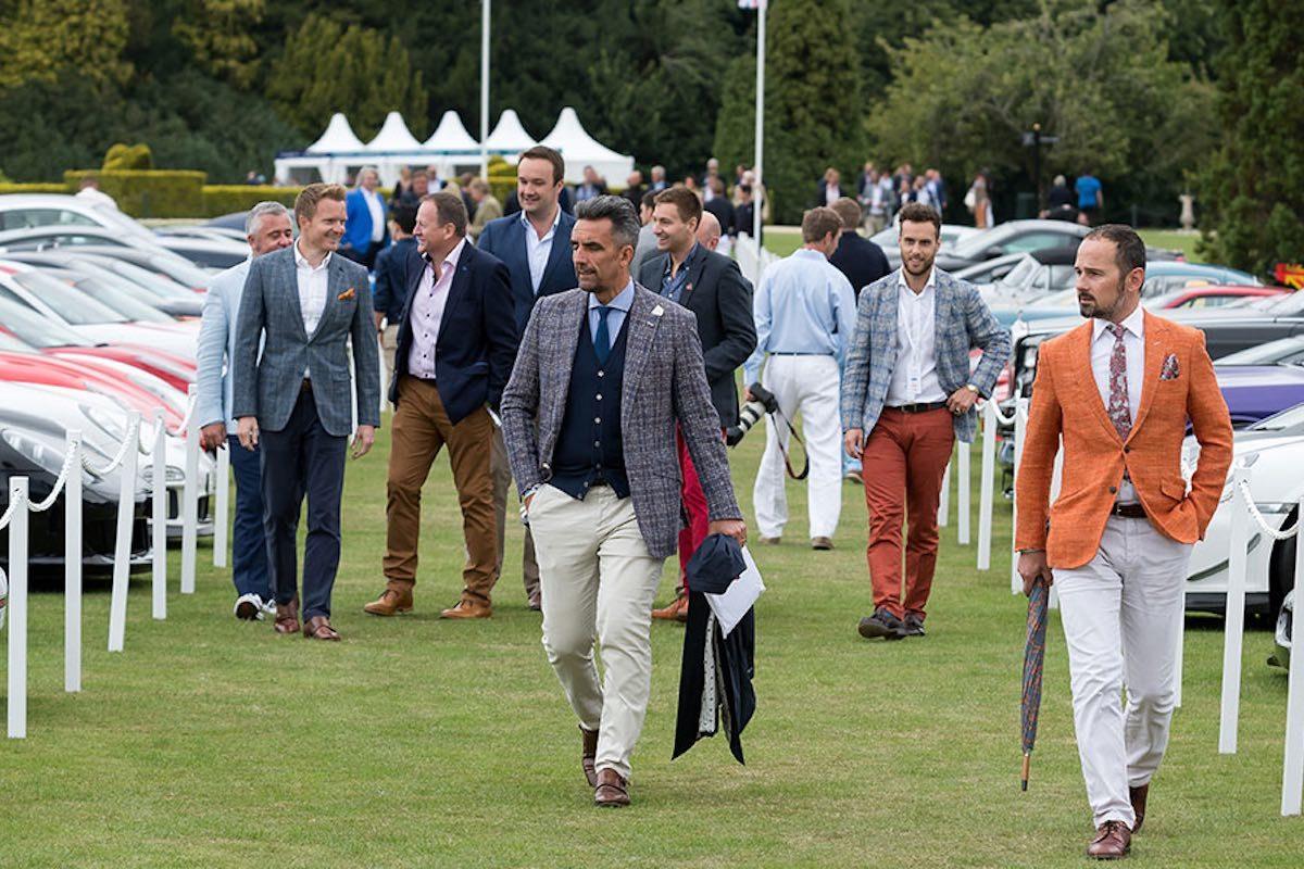 well dressed men at salon prive