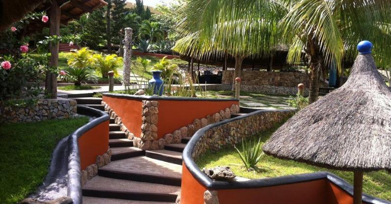 hillburi mountain escape orange walls and palm trees
