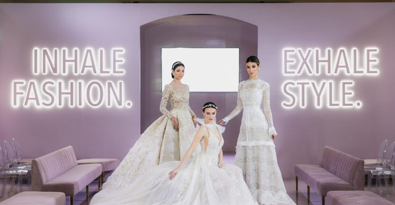 three brides in glamorous wedding dresses at wedluxe show