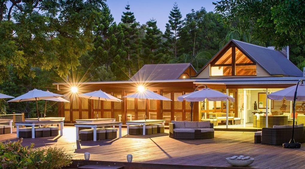 Gwinganna Resort seatig an umbrellas at sunset