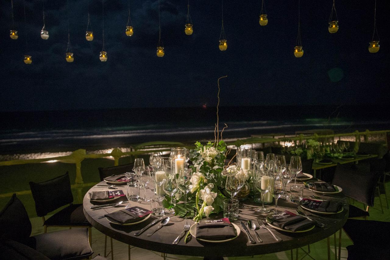 nighttime dinner on the beach at casa malca