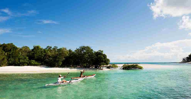 kayakers in ocean on vamizi private island